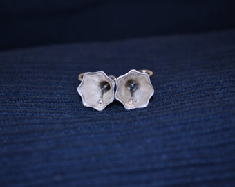 Heptagonal bell earrings