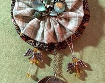 Blessings of Peace Yoyo Brooch from Promise Cottage