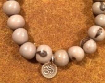 natural grey acai bead elastic bracelet