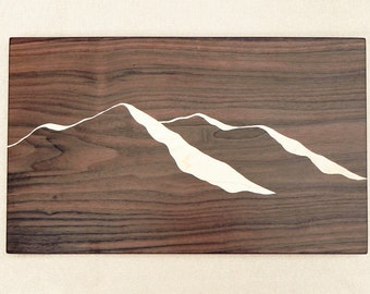 Unique dark wood cutting board with mountain ridge view, handmade with black walnut and curly maple