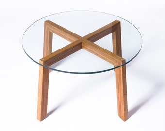 Glass-topped round modern wood coffee table
