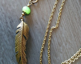 Green Feather necklace - Feather bronze and green faceted glass bead