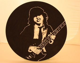 Angus Young  Or  AC/DC