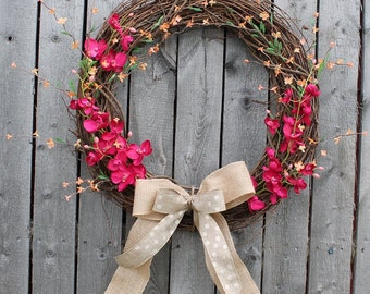 Grapevine wreath with maroon and orange flowers