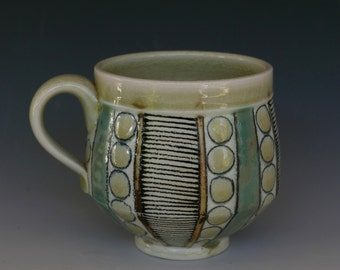Soda fired porcelain mug