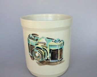 Ceramic pottery cup with hand painted slr camera