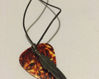 guitar pick & feather - music lover