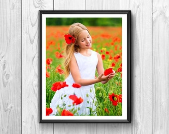 little girl,carefree and cheerful little girl in the middle of a field of poppies