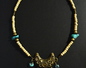 Wooden, turquoises and coral necklace
