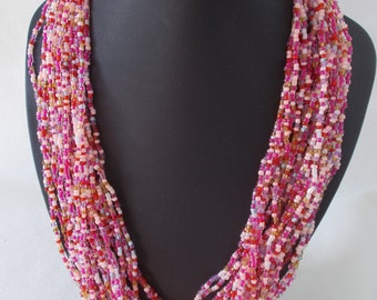 The original one row necklace of beads. Handmade. Pink Necklace.