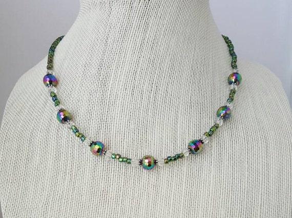 Iridescent green necklace with facated beads