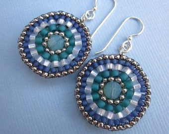 teal green, powder blue and nickel silver seed bead stitched mandala earrings