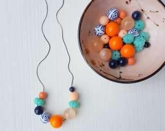 new day necklace - vintage lucite - autumn colors - chevron - orange mint navy