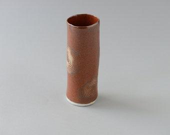 Hand built porcelain red bud vase with spiral patterns