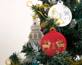 Red christmas ball ornament with reindeer pattern laser engraved and hand painted in gold