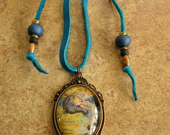 "Believe, 30 mm x 40 mm glass dome pendant in a brass frame with a 40"" adjustable blue deerskin leather cord, with trade beads"