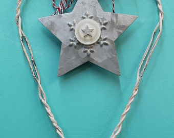 large handmade Christmas ornament made from white wire from snow fence with galvanized star with snowflake and vintage button