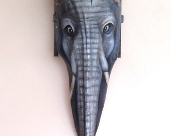 Elephant Tiki Mask on Palm Frond Branch