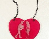 BLIND DATE-Translucent Red Etched Zombie Girl Meets Boy Next Door Laser Cut Acrylic Heart Necklace