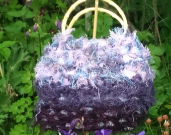 Crochet tassle fringe handbag in colours and tones to reflect the landscape.