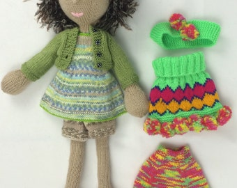 Brown-haired knitted doll with extra clothes