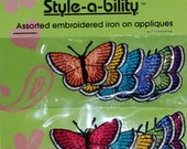 Style-a-bility 12 Butterfly assorted embroidered iron on appliques. 12 per pack