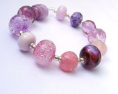 Handmade lampwork glass bead set of 12 mainly pink renegade lampwork orphans