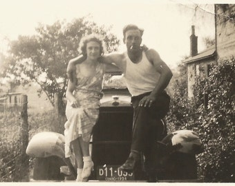 "Vintage Photo ""Married To A Bad Boy"" Couple Sitting on Hood of an Old Car - Smoking Cigarette - White Sleeveles Undershirt - Snapshot"