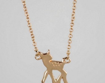 DOE >>Gold Fawn Charm >> Adorable animal necklace >> seriously this doe is so cute you can't look directly at it >> donates to Humane