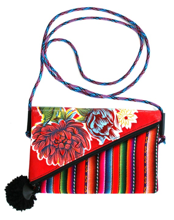 Small, pom pom, adjustable strap, red, floral oil cloth, Peruvian stripes, cross body bag, flat bag