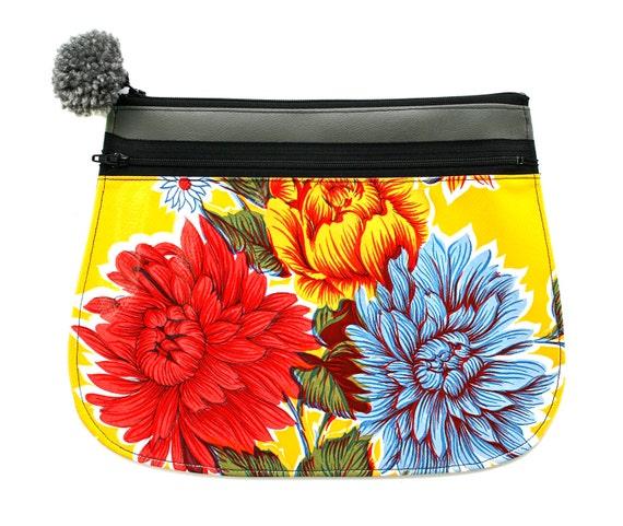 Clutch, vinyl, oil cloth, yellow floral, pom pom, zipper top, vegan