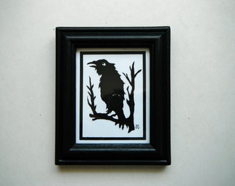 Framed Papercut Raven. In Black and White