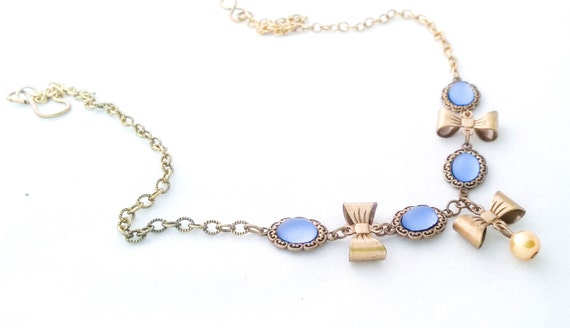 Vintage Victorian Sapphire Blue Lucite Cabochon Necklace with Brass Etched Bows and Golden Glass Pearls