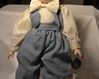 Brinns's musical porcelain doll-plays Raindrops keep falling on my head-1987