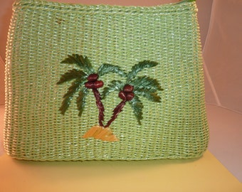 Vintage green straw purse with bamboo handles.