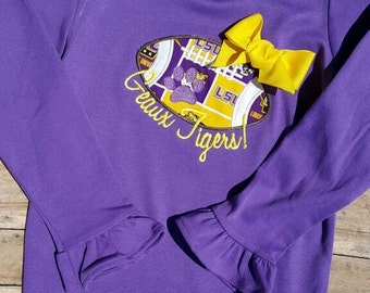 Girl's ruffled LSU Geaux Tigers! appliquéd football shirt with bow