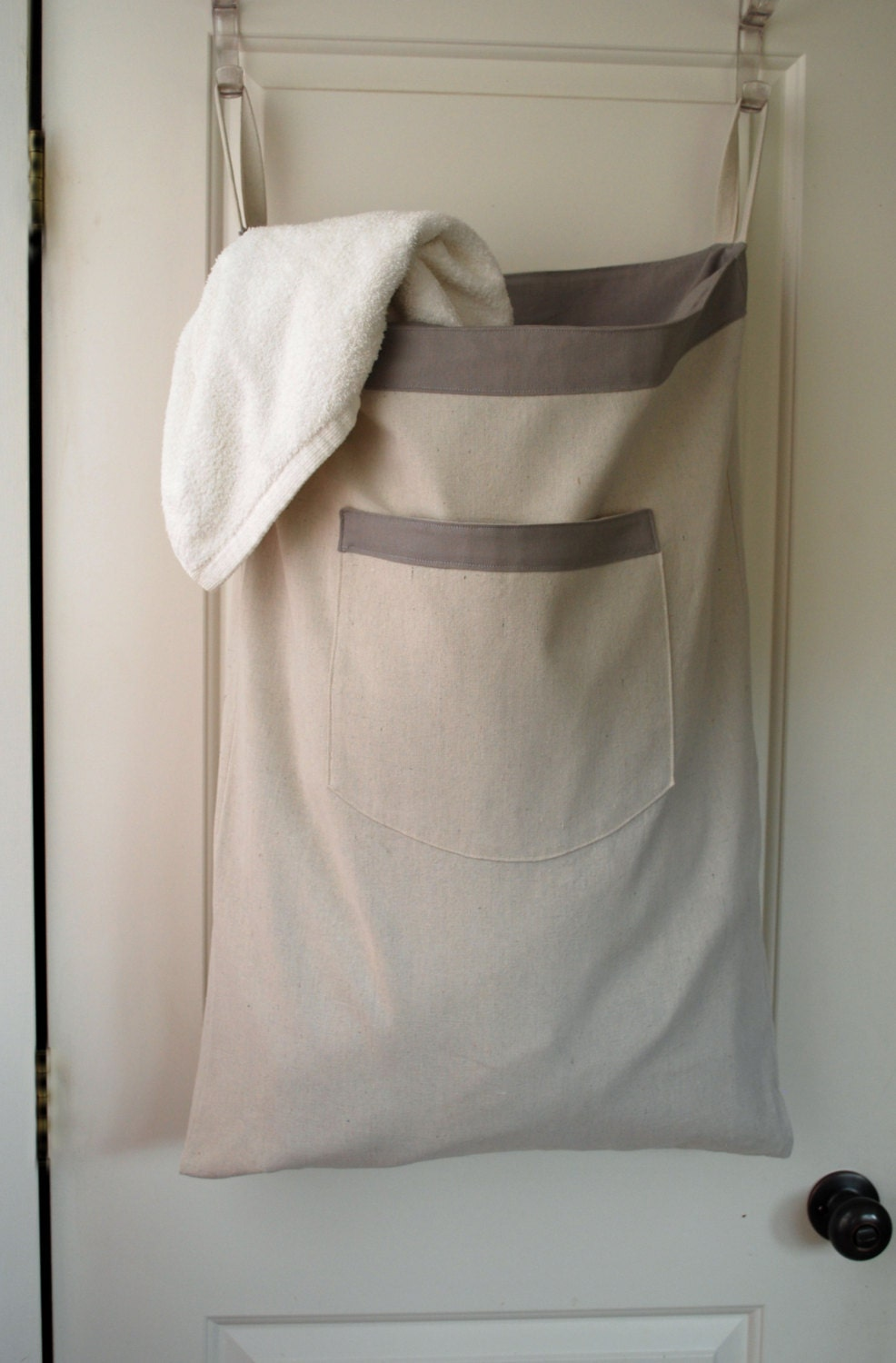 hanging her laundry bag gray drawstring bag with
