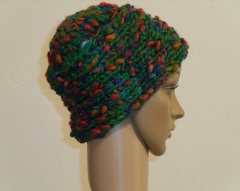 Knitted green cap with colored dots