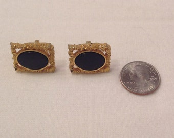 Vintage gold tone and black cuff links