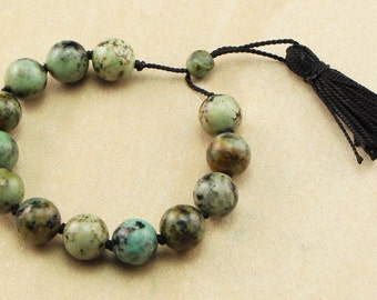 African Turquoise and Black Silk Cord Bracelet Hand Knotted with Tassel Closure