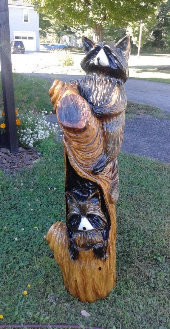 Raccoons wood carving chainsaw rustic art