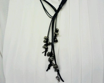 Raw pyrite and black leather necklace