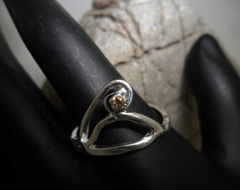 Set with a champagne diamond sterling silver ring