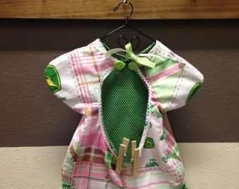 Clothes pin bag made vintage style to look like a cute little dress. Has John Deere fabric. Would look nice in any home sweet home.