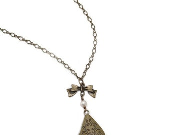 locket & pearl necklace, flower locket necklace, lotus locket necklace, vintage style locket necklace, teardrop locket,bow and flower locket