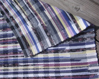 shades of lilac, purple, grey and yellow handwoven rag rug made from recycled t-shirts