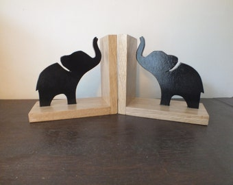 A Pair of Hand Made and Hand Painted Black Elephant Bookends