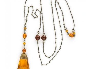Vintage Art Deco lavaliere necklace of brass chain and amber glass (nlad916)