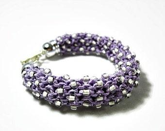 Knitted bracelet in violet color shiny ribbon yarn and Toho beads, modern bracelet, gift ideas, Christmas gift
