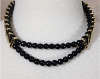 Short black beaded double stranded necklace with gold accents